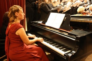 The composer, Esther Upham, at the piano.